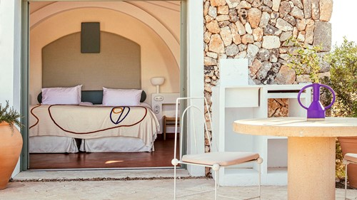 view of bedroom with terrace at Experimental Menorca, luxury holidays Spain